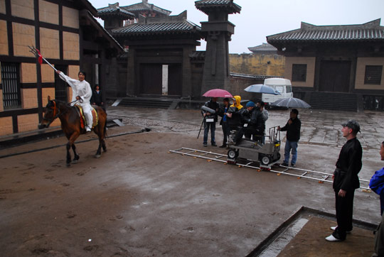 Actor on horse with crew